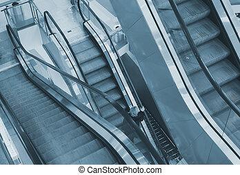 Escalator in the shopping mall interior.