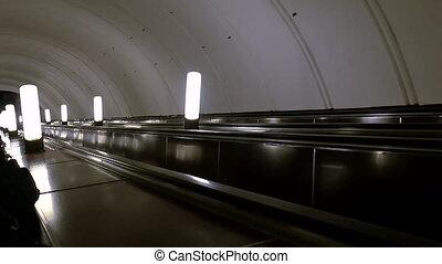 Escalator in the subway moving down. Moscow metro station Aviamotornaya