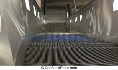 Escalator moves up to the camera.