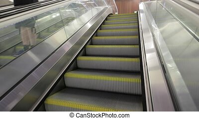 Escalator of a metro station - Empty escalator moving at a...