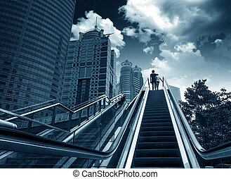 Escalator of Shanghai streets, skyscraper buildings.