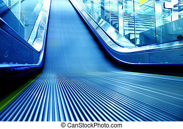 escalator of the subway station in modern building