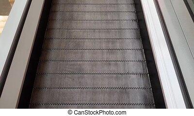 escalator path at the airport or subway. urban...