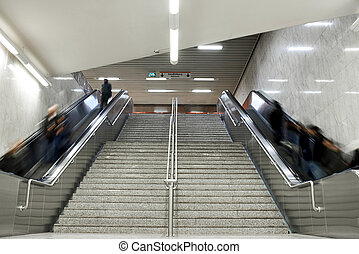 Escalator stairs with crowd