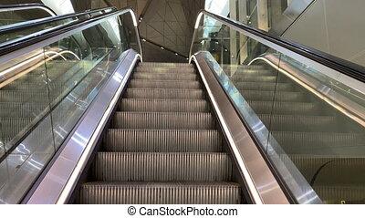 Escalator to check-in hall at Saint Petersburg Pulkovo airport, air traveler pov