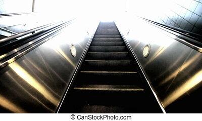 Riding up an escalator into the light