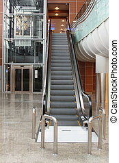 Escalator with elevator at the airport