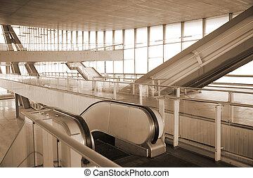 Escalators in glass hall