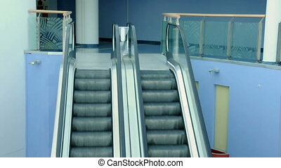 Escalators in shopping center