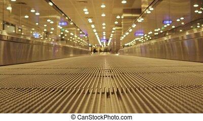 Escalators stairway inside modern airport.Motion Travelator...