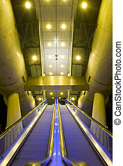 Escalators, leading up to the platform of an elevated tram...