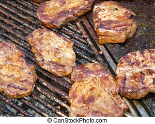 Escalope on grill - Juicy mopped escalope grilling on coal...