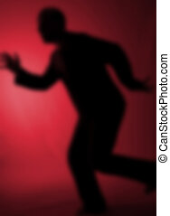 escaping as dream nightmare concept. abstract image of man in flight or motion running on the spot