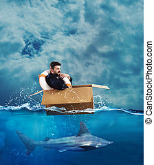 Escape from crisis - Fearful Businessman on a cardboard in...