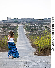 Lonely woman in middle of nowhere running away in fear