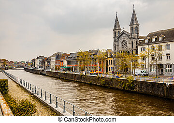 Escaut river and street with old belgian houses and facade ...