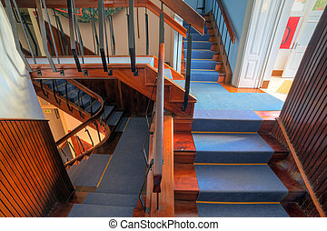 Beautiful view of an escher like staircase in a house with stairs going everywhere and nowhere