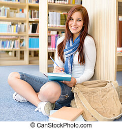 escola, alto, estudante, sorrindo, biblioteca, notepad