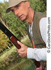 escopeta, cazador