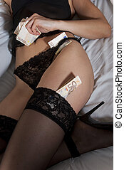 Escort fee - Some fifty euro banknotes are inserted in...