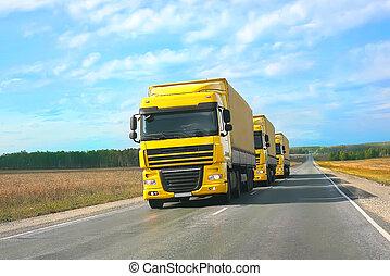 escort of yellow trucks