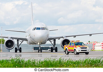 Escorting a passenger airliner by car - follow me after landing at the destination airport.