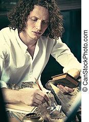 escritor, en, work., guapo, joven, escritor, el sentarse en la tabla, y, escritura, algo, en, el suyo, sketchpad