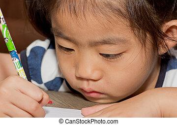 escritura, niño, primer plano, notebook., cara