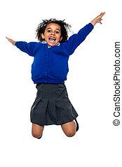 escuela, arriba, aire, saltando alto, niño, jubiloso