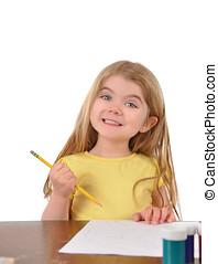 escuela, niño, escritura, en el escritorio, blanco