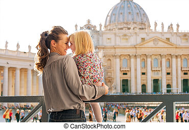 Eskimo kisses between mother and child at the Vatican in Rome