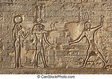 Reliefs showing Khnum with his consort Neith in her Lion Headed form from the Temple of Esna, Egypt