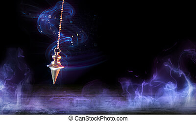 Esoteric And Hypnosis Concept-Pendulum Swinging With Magic Smoke