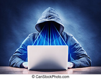 espionage - picture of an hacker on a laptop