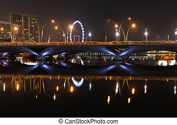 Esplanade bridge, theater and Singapore Flyer at night - ...