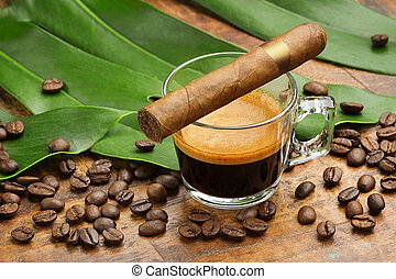 espresso and cigar - coffe cup and cigar, coffee beans and...