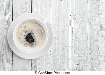 coffee cup top view on white wood table background -...