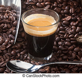 Espresso coffee in glass cup with coffee beans. - Espresso...