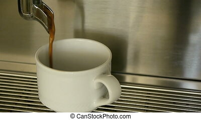 Espresso coffee pouring in cup