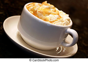 Espresso coffee topped with whipped cream and caramel