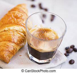 Espresso coffee with a croissant