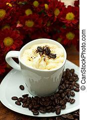 Espresso con panna coffee and Red chrysanthemum flower