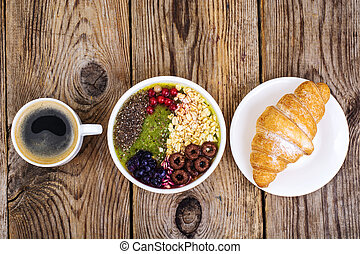 Espresso, croissant and fruit dessert for breakfast