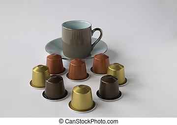 Espresso cup and saucer with coffee pods