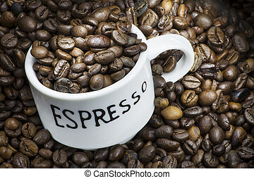 Espresso cup with coffee beans - White espresso cup full of...