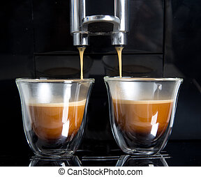 golden espresso flowing into the cups