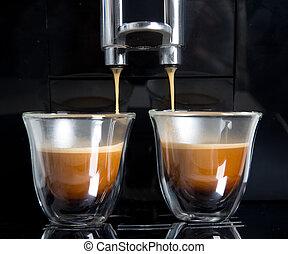 Espresso - golden espresso flowing into the cups