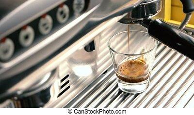 Espresso machine and shot glass.