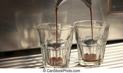 Espresso machine and two glasses. Fresh hot coffee.
