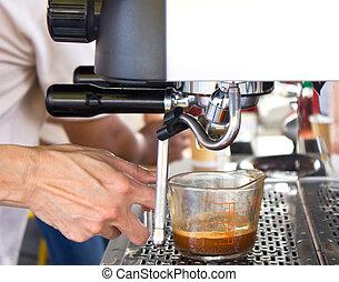 Espresso machine brewing a coffee.